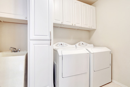 laundry room: White laundry room with washer and dryer. Northwest, USA