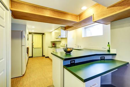 linoleum: White basement kitchen room with green counter tops and linoleum flooring. Northwest, USA
