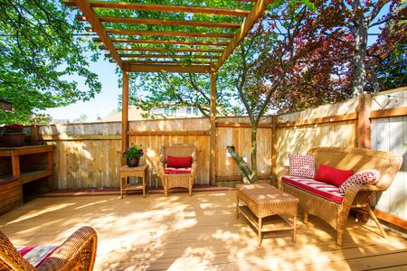 northwest: Backyard deck with wicker furniture and pergola. Northwest, USA