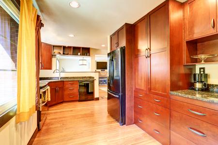 black appliances: Kitchen interior with black appliances, large storage combination and granite tops. Northwest, USA Stock Photo