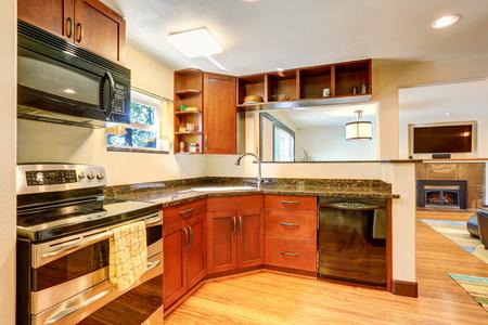 black appliances: Kitchen interior with black appliances and granite tops. Northwest, USA