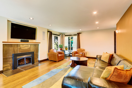 sofa set: Living room interior with leather sofa set and fireplace. Northwest, USA