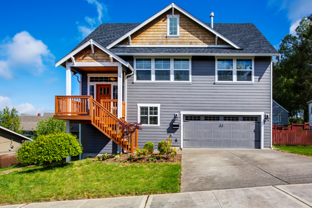 northwest: Luxurious gray house with front stairway and porch. Northwest, USA Stock Photo