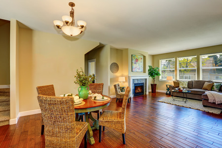 Open floor plan of dining and living room. Dining Furnished with dinner table and nice wicker chairs. Northwest, USA