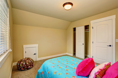 northwest: Large beige girl bedroom interior with pink bed. Northwest, USA