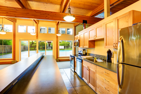 open plan: Open floor plan kitchen room. Exit to backyard swimming pool. Northwest, USA Stock Photo