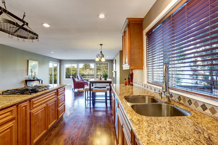 Open floor plan. Kitchen room interior with island and granite counter top. Northwest, USA Stock Photo