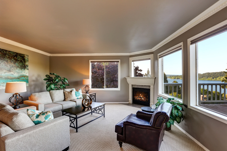 Cozy living room interior with fireplace and black coffee table. Northwest, USA