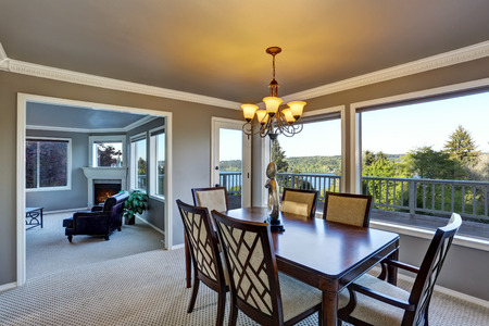 open floor plan: Open floor plan dining area with perfect water view through windows. Northwest, USA