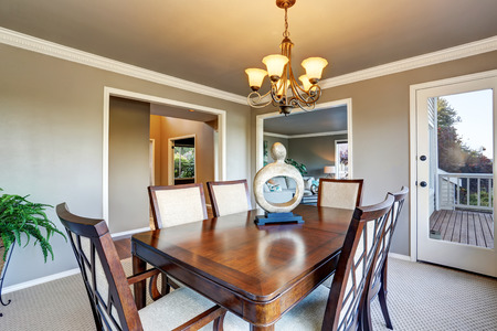 open floor plan: Open floor plan dining area with exit to walkout wooden deck. Northwest, USA