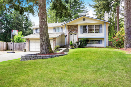two story: American two story house exterior with garage and double entry door. Well kept lawn. Northwest, USA Stock Photo