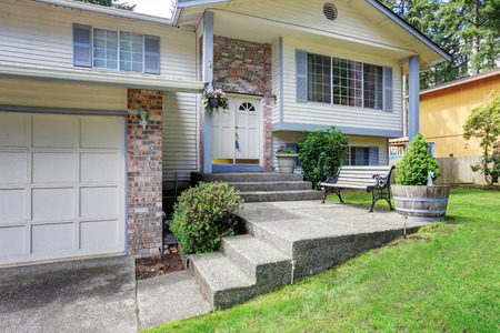 curb appeal: American two story house exterior with garage and double entry door. Well kept lawn. Northwest, USA Stock Photo
