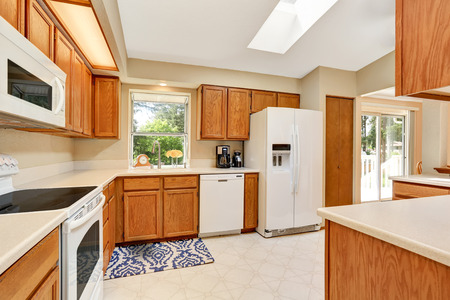 Kicthen room interior in white tones with wooden cabinets and white counter top. Northwest, USA Stock Photo