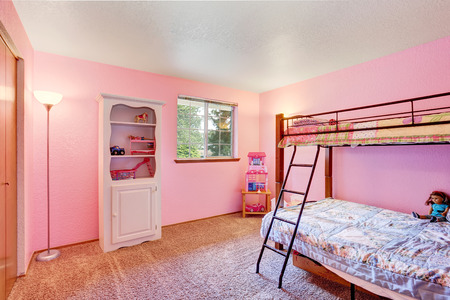 idea comfortable: Pink kids bedroom with white furniture and carpet floor. Northwest, USA