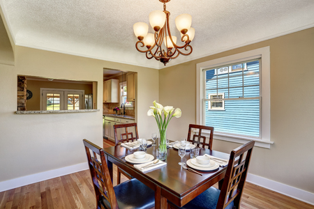 open floor plan: Open floor plan. View from dining area with wooden table set. Northwest, USA Stock Photo