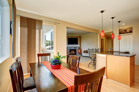 open floor plan: Dining area with wooden table set. Open floor plan. Kitchen room and living room. Northwest, USA