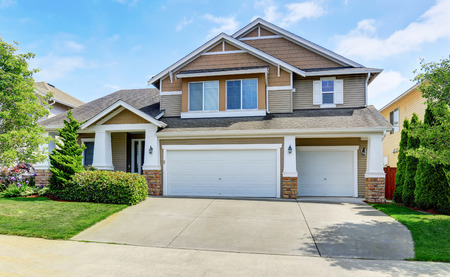 Classic American house exterior with siding trim and garage. Northwest, USA