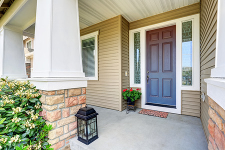 front porch: Front entry door with concrete floor porch and flowers pot. Northwest, USA
