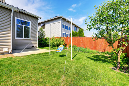 Playground for kids on backyard. Backyard with lawn and trees. Northwest, USA
