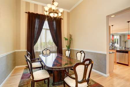 Dining room interior with nice table set and brown curtains. Northwest, USA