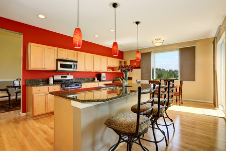 granite wall: Kitchen room interior with red wall, granite counter top and island. Northwest, USA