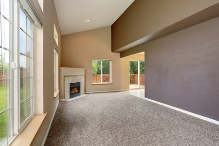 remodeled: Empty living room interior in light tones and fireplace. Northwest, USA