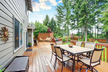 pergola: Spacious wooden deck with patio area and attached pergola. Northwest, USA
