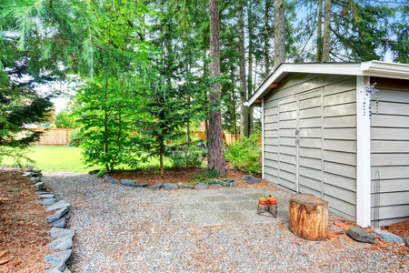back yard: Fenced back yard with well kept garden and siding barn shed. Northwest, USA