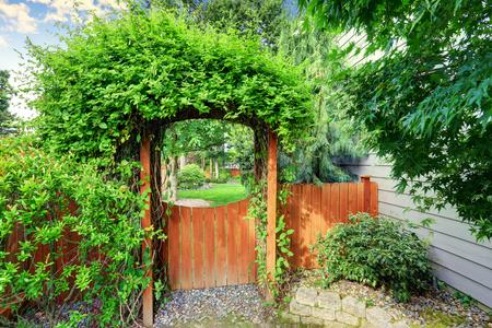 northwest: Nice wooden gate with well kept garden. Northwest, USA