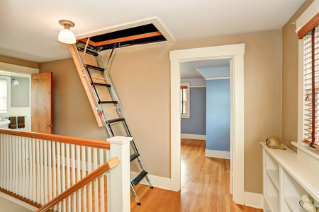 Hallway interior with folding attic ladder. Northwest, USA Stock Photo