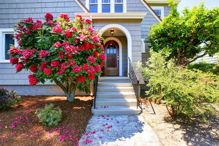 American craftsman house exterior. View of entry door and porch with concrete stairs. Northwest, USA Stock fotó