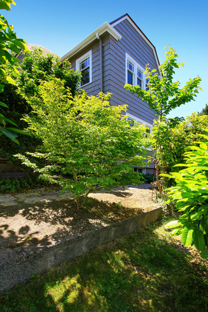two level house: American craftsman two level house exterior. View from garden. Northwest, USA Stock Photo