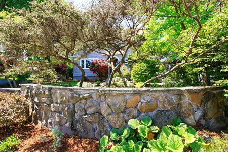 American craftsman house exterior. Nice landscape design around. View from garden. Northwest, USA