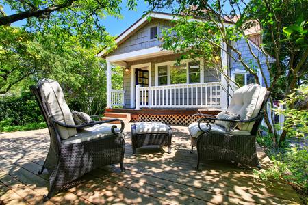 Cozy wooden floor patio area at backyard of craftsman American house. Northwest, USA Stock fotó