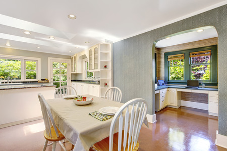 Dining area with table set in white tones and tile floor. Northwest, USA