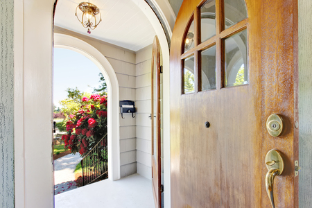 Nice bright entry way to home with concrete porch area and old sharpen door. Northwest, USA Stock Photo