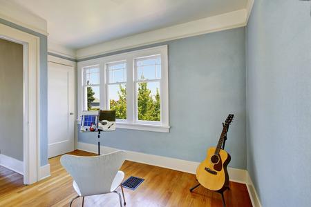 remodeled: Musician home studio interior in blue tones. Guitar. Northwest, USA