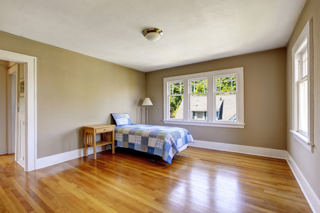 northwest: Bedroom interior with beige walls and hardwood floor. Northwest, USA
