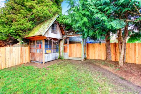 northwest: Back yard with wooden fence and barn shed. Northwest, USA