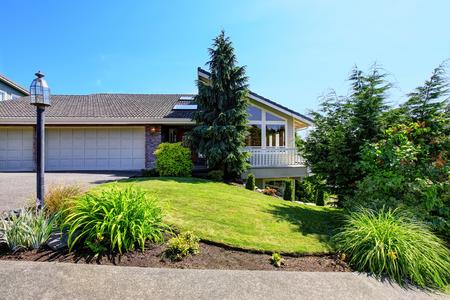 desing: Luxury house exterior with garage and large balcony. Nice landscape desing around. Northwest, USA Stock Photo