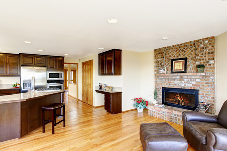 open floor plan: Open floor plan kitchen and living room interior with brick fireplace. Northwest. USA