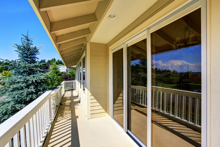 wooden railings: Balcony house exterior with wooden railings and perfect view. Northwest, USA
