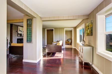 pannel: Hallway interior with wooden pannel trim and hardwood floor. View to open floor plan living room. Northwest, USA