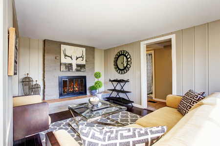 open floor plan: Open floor plan living room with fireplace and comfortable beige sofa. Northwest, USA Stock Photo