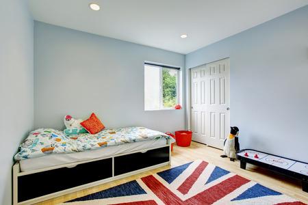 Modern kids bedroom interior in blue tones, hardwood floor and walk-in closet. Northwest, USA