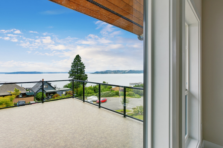 green building: Unfurnished and empty balcony with perfect water view. Northwest, USA