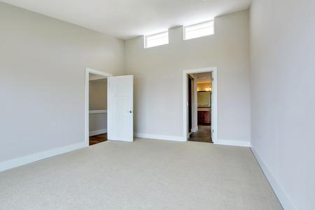 remodeled: Empty room interior with carpet floor and opened bathroom door. Northwest, USA