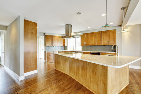 cabinets: Kitchen room interior with wooden cabinets, granite counter top and island. Northwest, USA