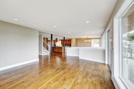 remodeled: Open floor plan. Empty living room interior in light tones with hardwood floor. Connected to kitchen. Northwest, USA