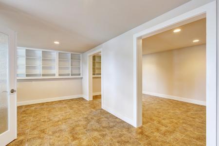 open floor plan: Open floor plan interior with light tones walls and tile floor. Also buil-in shelves. Northwest, USA Stock Photo